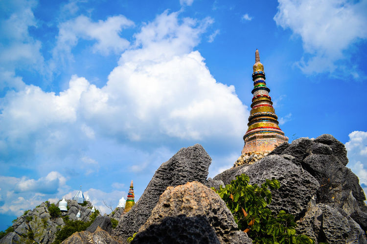 Pagodas on the mountain Lampang Thailand Architecture Belief Blue Sky Buddhism Built Structure Cloud - Sky Day History Low Angle View Nature No People Outdoors Place Of Worship Pogada Religion Sky Travel Travel Destinations