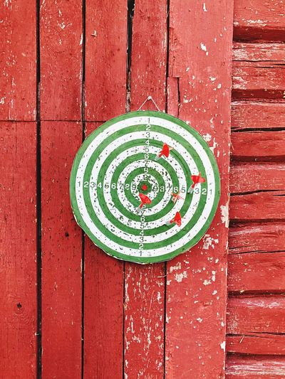 Close-up of dartboard hanging on wall