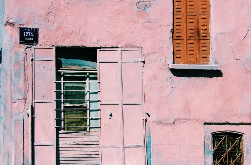 Low angle view of window on building pink