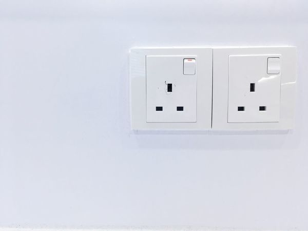Two wall power outlets. Electricity  Power Supply Connection Power Outlets Office On Off Danger 3 Points White Wall Danger High Voltage Office Safety Wall Plugs Power Outage Save Electricity Save Money Save Earth Energy Waste
