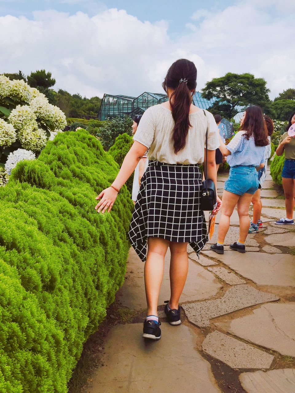 real people, full length, rear view, leisure activity, casual clothing, day, young women, walking, togetherness, outdoors, lifestyles, young adult, two people, standing, bonding, friendship, sky, women, tree