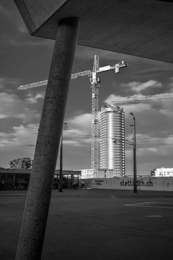 perspectives - to see the big things behind the small things Architecture Reflection Roof City Blackandwhite Sky Industry Perspectives Tower Skyscraper Evening Light Cityscape Monochrome Tall Construction Site Scenics Tranquil Scene Building Exterior Tall - High Built Structure Architectural Column Crane - Construction Machinery Oil Pump The Architect - 2019 EyeEm Awards Grytecture