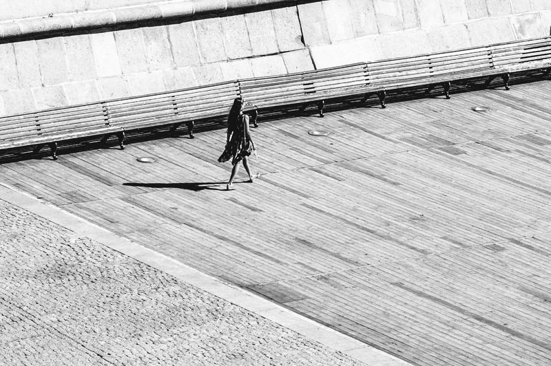 High Angle View Of Woman Walking On Boardwalk