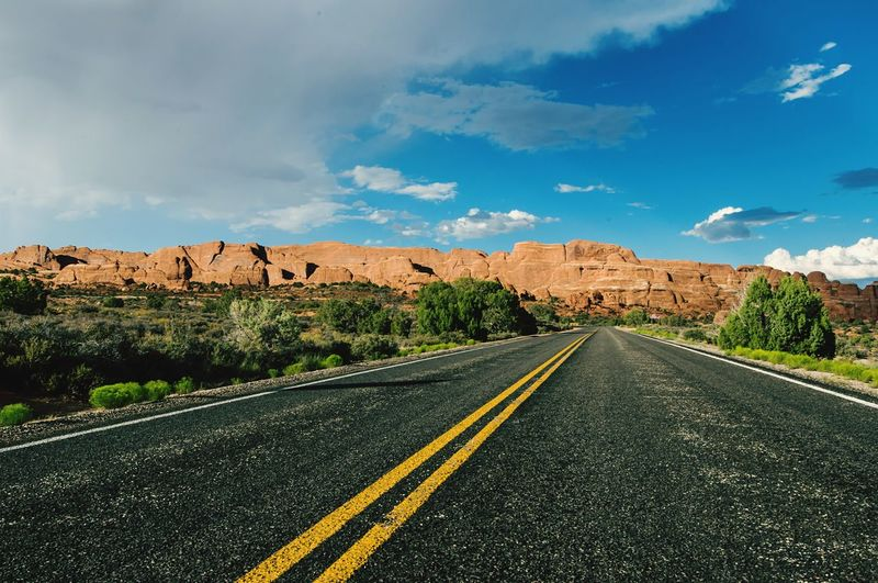 Empty road leading towards red rock canyon national conservation area