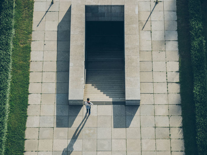 High Angle View Of Man Standing By Steps