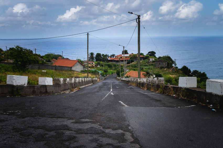 madeira coast line street Coastline Madeira Island Architecture Building Building Exterior Built Structure Cloud - Sky Connection Day Diminishing Perspective Direction Horizon Horizon Over Water Nature No People Outdoors Road Sea Sign Sky The Way Forward Transportation Village Water