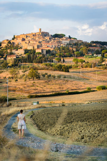 vacation in italy Autumn Road Tuscany Woman Architecture Building Built Structure Casale Marittima Cloud - Sky Day Europe Evening Girl Grass Historic Italy One Person Outdoors People Sky Town Vacation Lost In The Landscape Be. Ready. #FREIHEITBERLIN