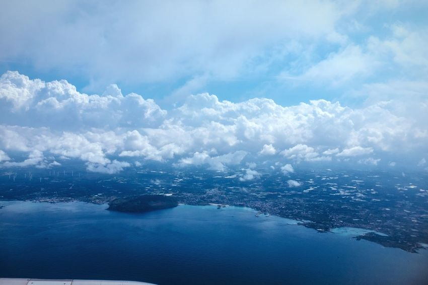 Shoreline of Tamra Island Scenics Nature Sea Water Sky Beauty In Nature Aerial View Tranquil Scene Outdoors No People Landscape Cloud - Sky Jeju JEJU ISLAND  Blue Shoreline Coastline Island From An Airplane Window Clouds And Sky Seascape Flight Korea ASIA Volcanic Landscape