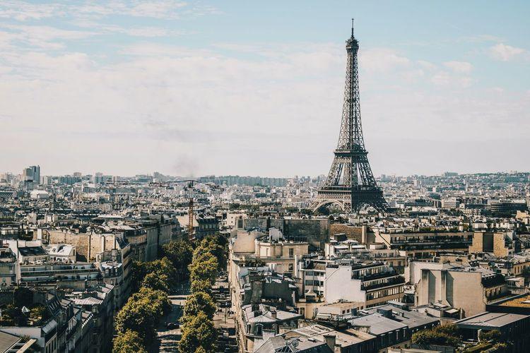 Eiffel tower and buildings against sky