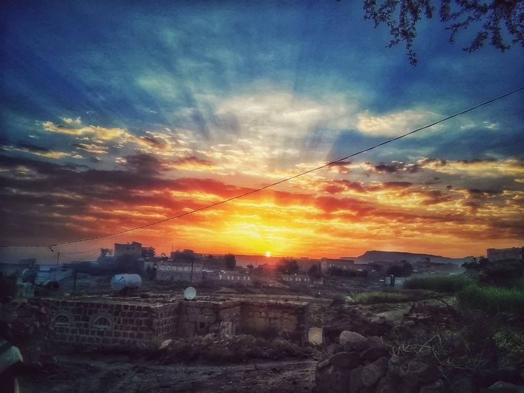 The moment of sunrise on the village is small Sunset Cloud - Sky Sky Dramatic Sky Outdoors Nature No People Day Beauty In Nature