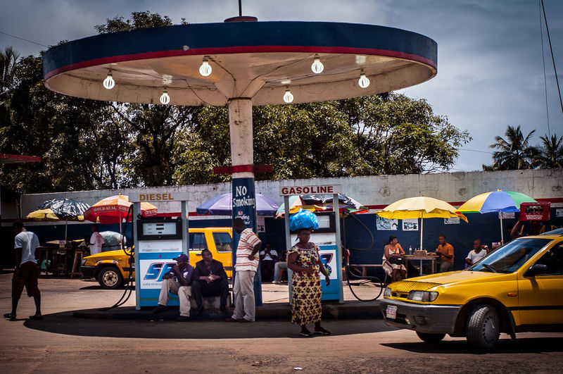 Mode Of Transportation Street Public Transportation Yellow Taxi Petrol Station Petrol Pump Petrolium Tankstelle The Weel On EyeEm Life At A Petrol Station Africa Day To Day Liberia Monrovia Normal Life Streetphotography Street Photography