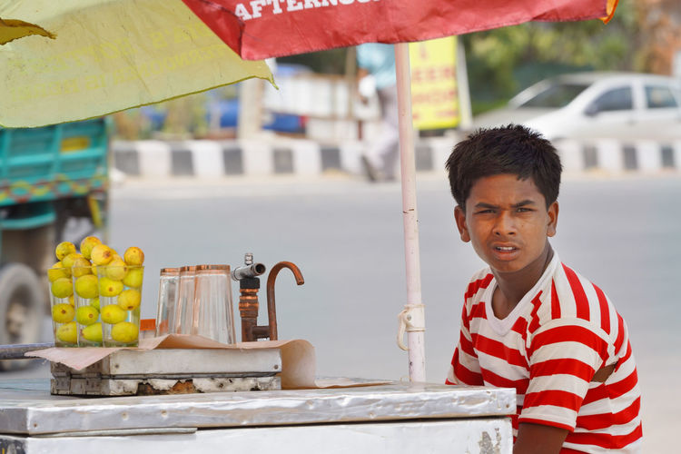 Lemonade Day Food Food And Drink Freshness Hot Day India Lemon Lemonade Man New Dheli One Person Outdoors Real People Shop Smiling Travel Trip Young Adult Live For The Story