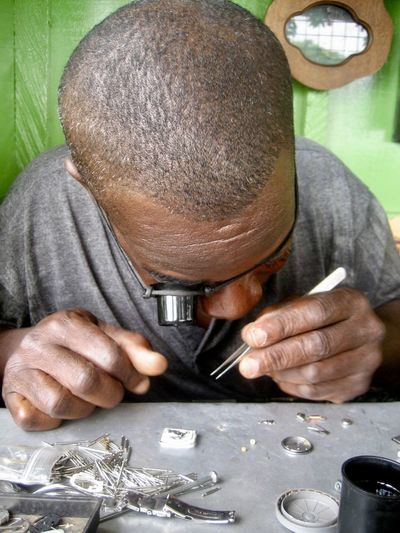 Enlarge Man Small Business Adult Africa Clockwork Concentrated Concentration Craft Craftman Craftmanship Enlargement Front View Handwork Holding Magnifying Glass Occupation One Person Repair Tweezers Watchmaker