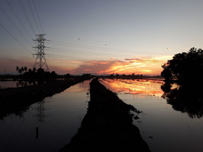 EyeEmNewHere Beauty In Nature Cable Electricity  No People Outdoors Power Line  Reflection Scenics - Nature Silhouette Sky Sunrise Tranquil Scene Tranquility Water