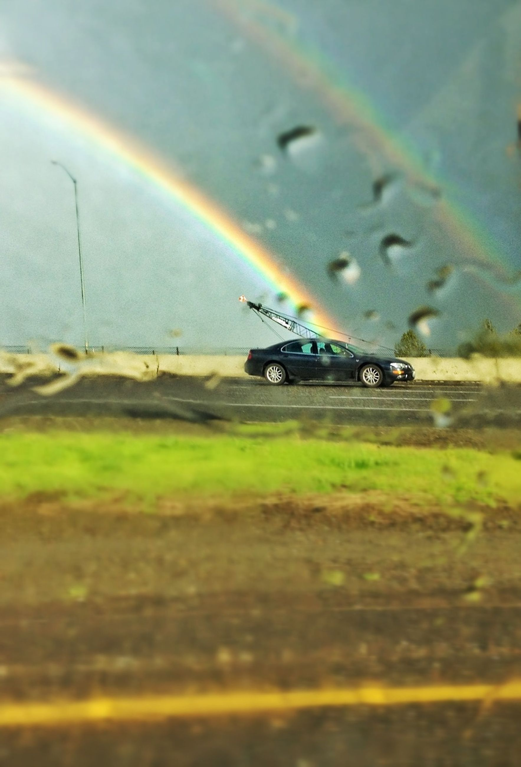 transportation, indoors, selective focus, multi colored, illuminated, transparent, glass - material, mode of transport, road, street, wet, vehicle interior, close-up, rain, no people, land vehicle, car, focus on foreground, defocused, window