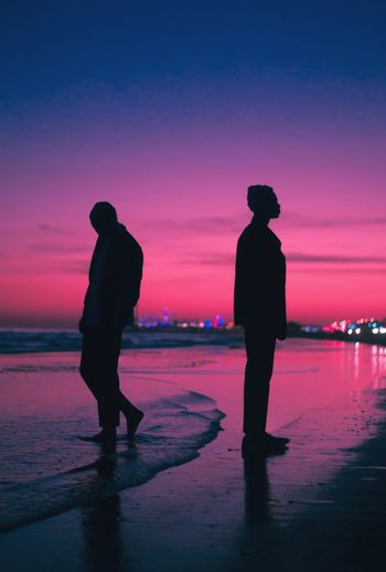 Separated Colors Color Pink Sky Retro Vintage Photographer Photography Photo Sunset Silhouette Beach Water Full Length Real People Sea Nature Two People Men Lifestyles Sand Sky Scenics Beauty In Nature Leisure Activity Dusk Standing Outdoors Vacations Colour Your Horizn