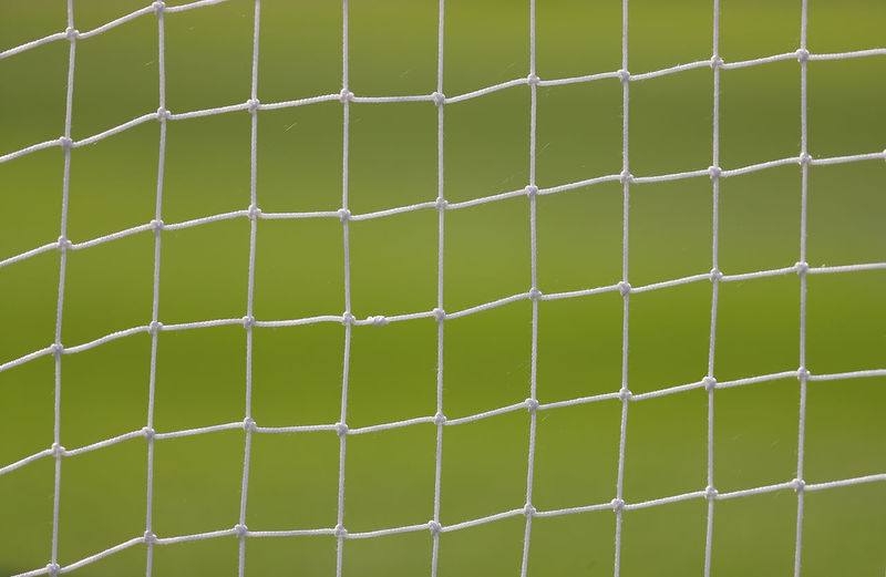 Full Frame Backgrounds Green Color Pattern No People Sport Grass Close-up Day Outdoors Wall - Building Feature Plant Net - Sports Equipment Nature Playing Field Team Sport Soccer Field Sports Equipment White Color Soccer