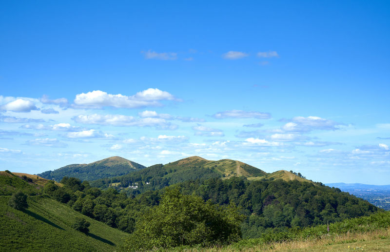 Views of the Malvern Hills in Worcestershire, UK, set against a blue sky with fluffy white clouds. Beauty In Nature British Countryside Day Landscape Malvern Hills Mountain Nature No People Outdoors Scenics Sea Sky Tranquil Scene Tranquility