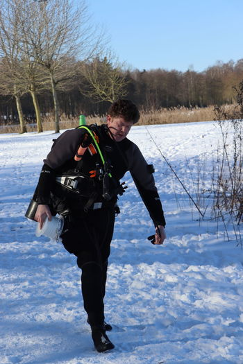 Full length of man on snow covered land