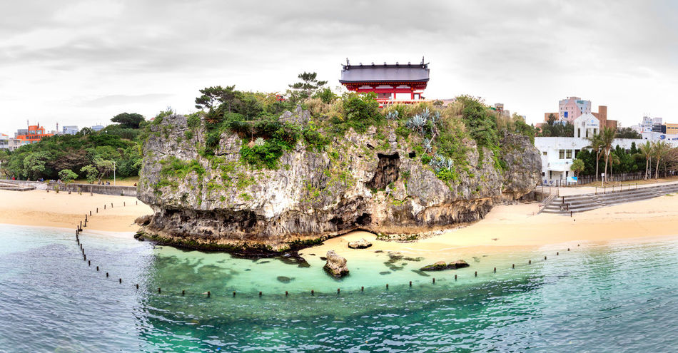 Shinto Shrine on a hall, facing the ocean Shinto Shrine Shrine Architecture Building Building Exterior Built Structure City Cloud - Sky Day Land Nature No People Outdoors Plant Religion Religious Architecture Sea Sky Travel Destinations Tree Water Waterfront