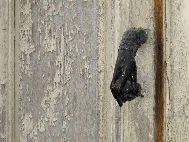 Cast Iron Cast-iron Knocker Close-up Day Door Hand Knocker Metal Metal Hand Metal Knocker No People Outdoors Steel Hand Steel Knocker Wood Wood - Material Wooden Door