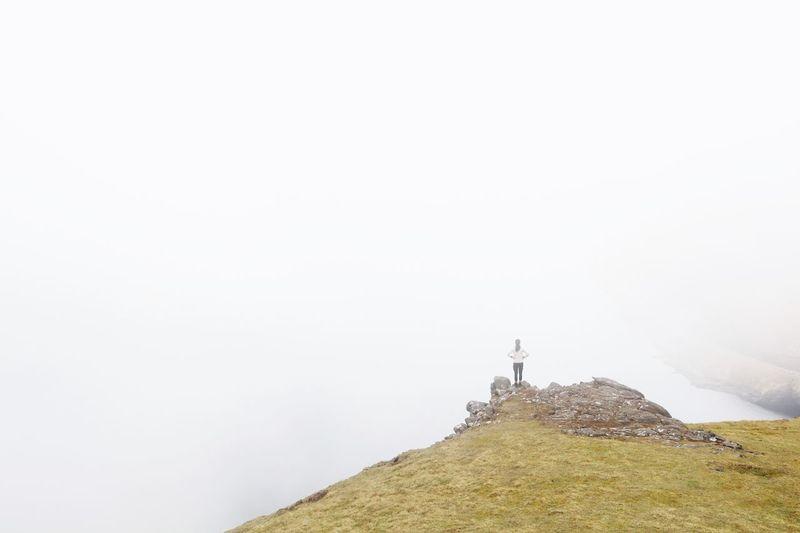 Cross on mountain against clear sky
