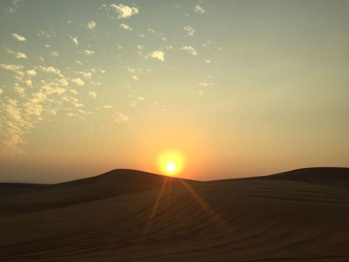 Silhouette Of Desert During Sunset