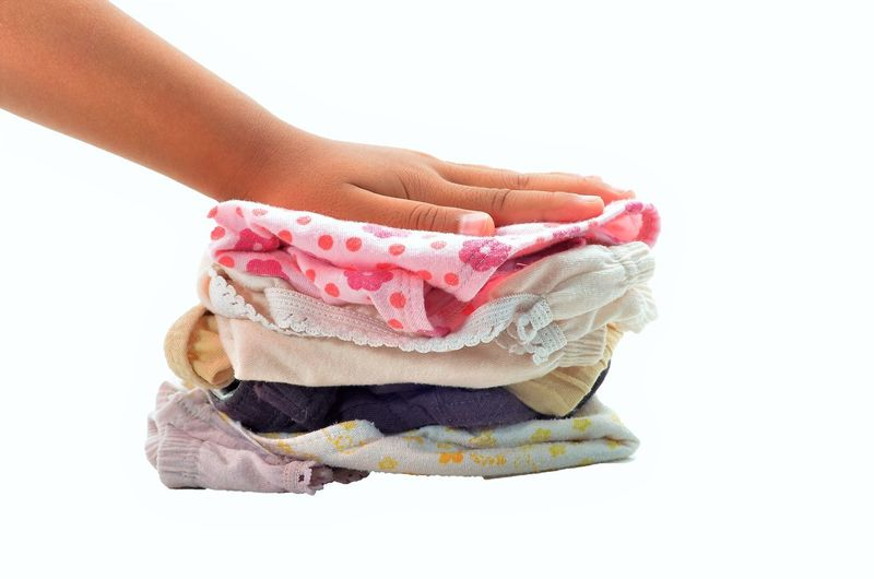 KIDS UNDERWEAR Pants Bloomers Body Part Close-up Copy Space Drawers Finger Freshness Hand Holding Human Body Part Human Finger Human Hand Human Limb Indoors  Knickers One Person Studio Shot Underpants Underwear😈 Unrecognizable Person White Background Women