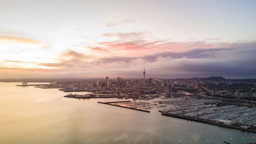 Aerial View Of Auckland City Waterfrontagainst Cloudy Sky