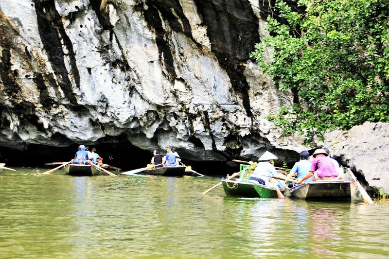 The three caves (Tom Coc) 0n Ngo Dong River in Vietnam Tourism Travel Destinations Waterfront Rock - Object Physical Geography Natural Pattern Beauty In Nature Rock Formation Nature Tom Coc, Viet River Mountain Water Outdoors Geology