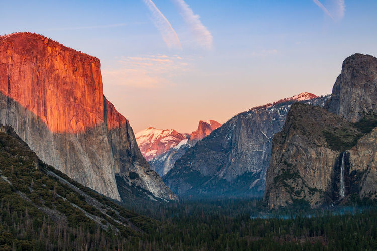 Scenic view of yosemite valley against sky during sunset