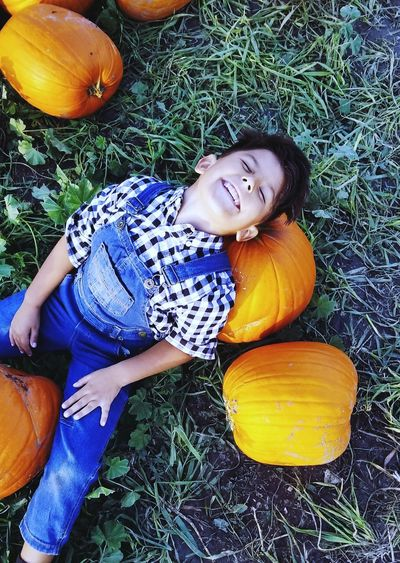 pumpkins Boys Will Be Boys Pumpkin Orange Color Beauty In Nature Beautiful Boy Life Flower Portrait Lying Down Leaves Fall Growing Autumn Autumn Collection Change Squash - Vegetable Scarecrow First Eyeem Photo