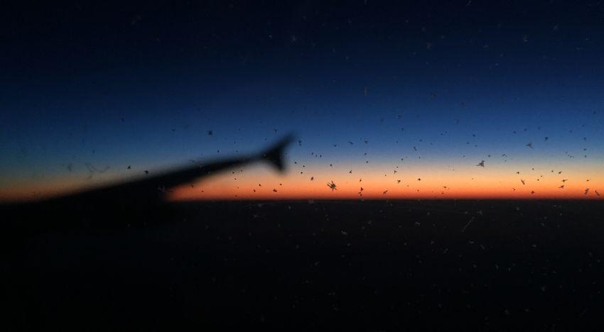 Dusk From An Airplane Window Flyswiss