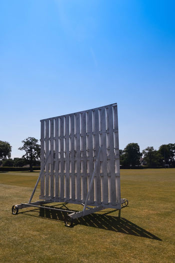 Absence Blue Built Structure Clear Sky Copy Space Cricket Day Field Grass Land Nature No People Outdoors Sight Screen Sky Sport Sunlight Sunny Tree