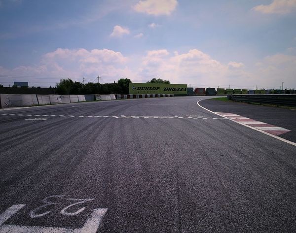 F1 is coming! Sign up and #Download #Free Lo-Res #Backgrounds images for your for #creative #layout now Learn more: garageimg.com GI-HST-1584-020759 Architecture Asphalt Automotive Built Structure Cloud Cloudy Day Empty Empty Road F1 Fomula1 Garageimg Road Road Marking Sky Sunlight Vanishing Point