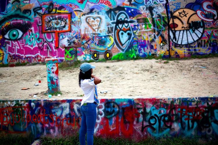 Multi Colored Creativity Graffiti Children Only Full Length Side View One Person Child Real People Outdoors People One Girl Only Childhood Day Photography Grafitti Wall Texas Travel Destinations Grafitti Park Austin Texas Photography Themes Chill Enjoying Life Drawing - Art Product Leisure Activity The Street Photographer - 2017 EyeEm Awards The Portraitist - 2017 EyeEm Awards Live For The Story