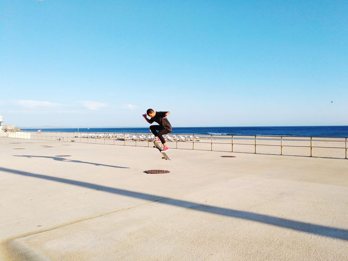 Skateboarding Beach Beauty In Nature Clear Sky Day Full Length Horizon Over Water Leisure Activity Lifestyles Nature Ocean One Person Outdoors People Real People Sea Shadow Skateboard Park Skater Sky Sport Sunlight Water Young Adult Young Women
