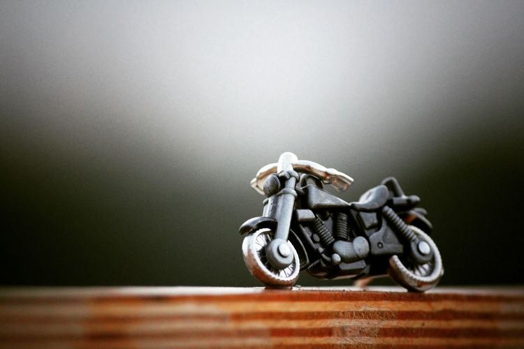 Close-Up Of Motorcycle Toy On Table