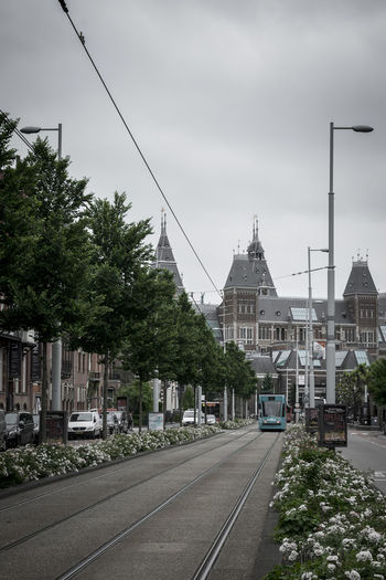 Amsterdam Tram Architecture Building Building Exterior Built Structure City Cloud - Sky Direction Mode Of Transportation Nature No People Outdoors Plant Rail Transportation Railroad Track Rijksmuseum Road Sky Street The Way Forward Track Transportation Tree