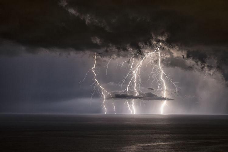 Lightning Over Sea At Night