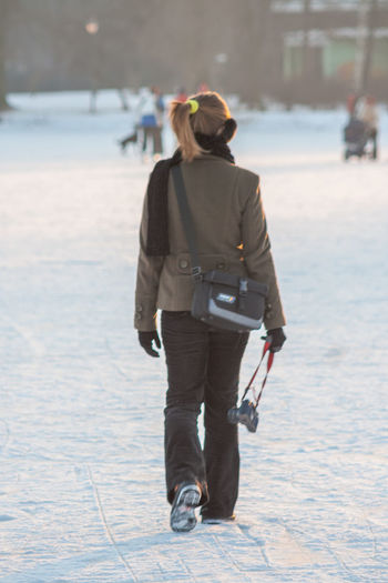 Girl with camera in winter Photographer City Clothing Cold Temperature Day Focus On Foreground Full Length Leisure Activity Lifestyles Nature One Person Outdoors Real People Rear View Snow Sunlight Walking Warm Clothing Winter Women