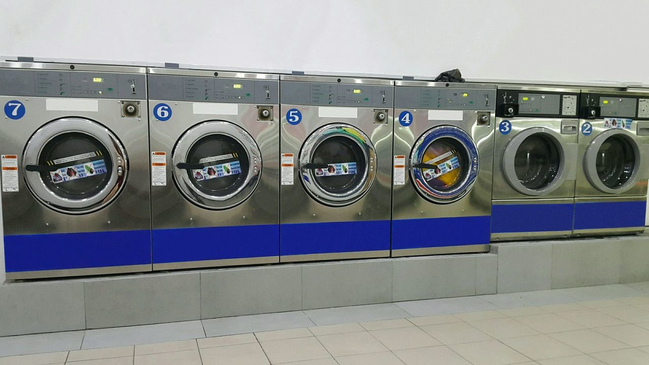 washing machine, laundry, laundromat, dryer, indoors, machinery, in a row, self service, convenience, technology, hygiene, illuminated, no people, day