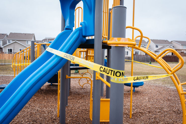 View of playground against blue sky