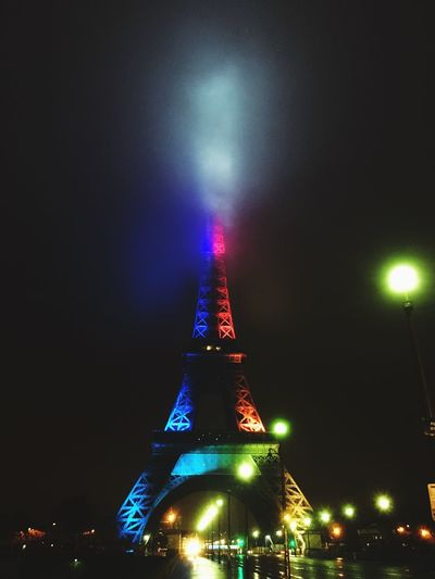 Night Illuminated Architecture Mystic Travel Destinations City No People Cloudy Sky Foggy Night With Street Lights Color Lights Eiffel Tower Eiffel Tower By Night Monument Bridge Street Lamp Streetphotography Metallic Structure Shinning Special Colour Paris Darkness And Light Bright Foggy Night Road Artistic Installations The City Light
