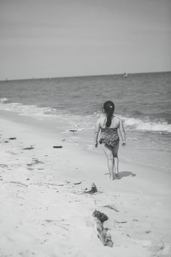 Beach walk Sea Beach Sand Horizon Over Water Shore Water Child Girl Walk Full Length One Person Nature Real People Standing Rear View Lifestyles Beauty In Nature Tranquility Scenics Leisure Activity Outdoors Be. Ready. Black And White Friday Summer Exploratorium