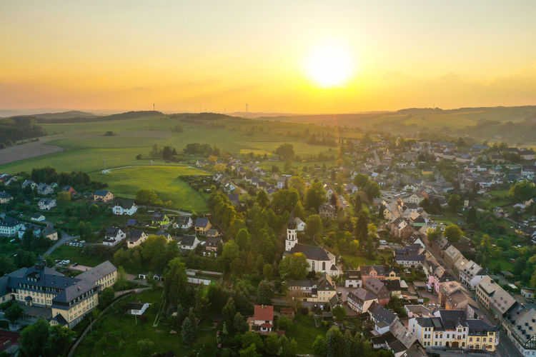 Aerial view of a small town in saxony, Germany - Hartenstein Church Hartenstein Village Town Sunset Nature Saxony Landscape Tree Rural Scene Sunset Dawn Backgrounds Panoramic Agriculture Fog Springtime Flower Head Blooming Agricultural Building TOWNSCAPE Farmhouse Rolling Landscape