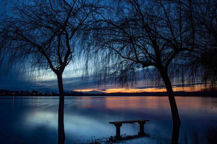 Bare Tree Beauty In Nature Lake Nature Night No People Outdoors Reflection Scenics Silhouette Sky Sunset Tranquility Tree Water