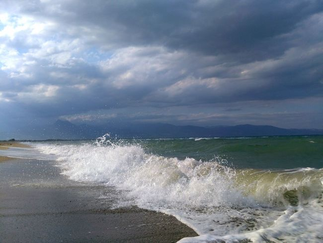 Sea Motion Wave Water Splashing Nature Outdoors Power In Nature Beauty In Nature No People Day Cloud - Sky Sky Horizon Over Water Honor Scenics Freshness Fragility Safety Relaxing Storm Cloud PhonePhotography Clear Sky Multi Colored Tranquility The Great Outdoors - 2017 EyeEm Awards