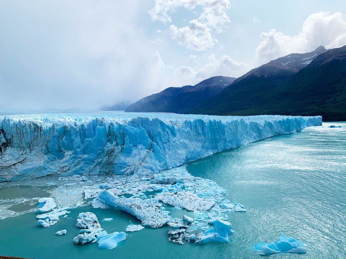 Scenic view of frozen lake against sky in perito moreno