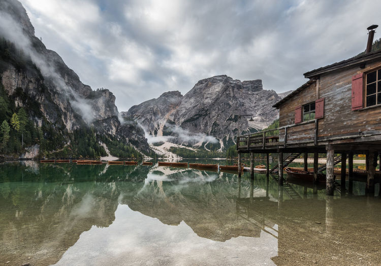 Lago di Braies classic Architecture Beauty In Nature Building Building Exterior Built Structure Cloud - Sky Day Lake Landscapes Mountain Mountain Range Nature No People Reflection Scenics - Nature Sky Tranquility Water Waterfront